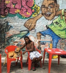 Sergio-and-Thor-at-MOF-Meeting-of-Favela-in-Rio-with-mural-from-last-year-by-Talu